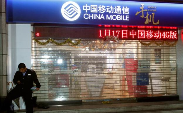 Tienda de China Mobile en Guangzhou (China)./Alex Lee (Reuters)